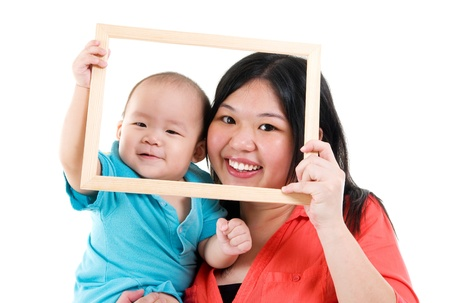 holding head: Asian mother and baby boy