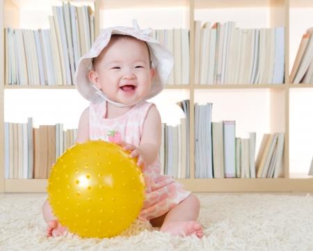 cute baby girl: baby girl holding a ball