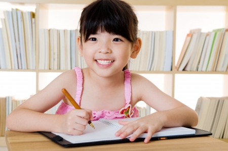 study: cute asian girl writing Stock Photo