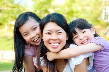 happy family garden: Outdoor portrait of asian family Stock Photo
