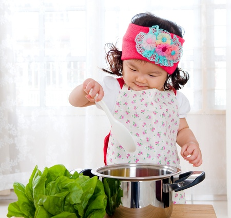 asian chef: Little chef in action Stock Photo