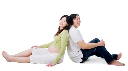 pregnant woman and husband sitting on the floor, thinking of their futures Stock Photo - 20150236