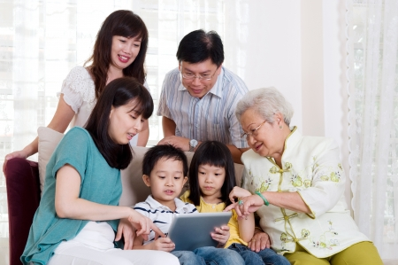 bonding: Asian three generations family having fun with tablet computer
