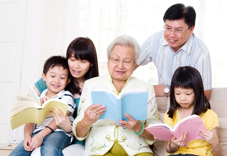 asian old woman: Asian family reading