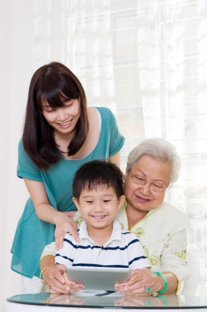 Three generations family having fun on the internet Stock Photo - 20206453