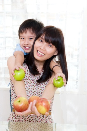 family eating: Healthy eating concept  mother and son holding apples
