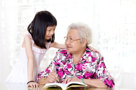 Asian senior woman and her granddaughter photo
