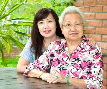 elderly care: Elderly woman and her daughter Stock Photo