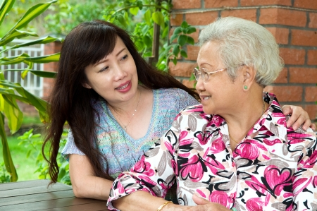 Senior woman talking with daughter photo