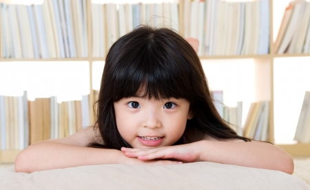 childcare: cute asian girl lying on the floor