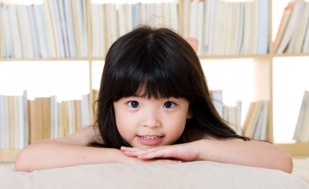 japanese children: cute asian girl lying on the floor
