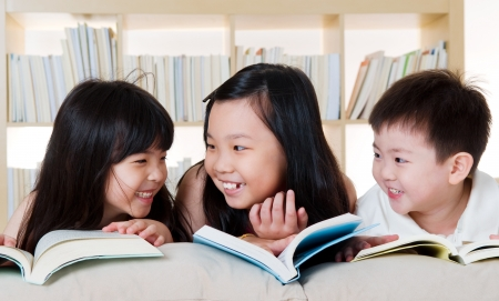 Asian kids reading photo