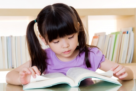 kids reading book: Asian girl reading a book