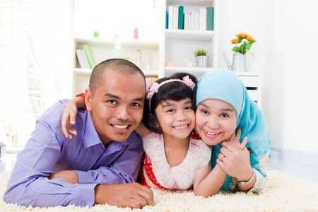 family living: muslim family lying on the floor