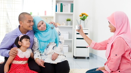 muslim family taking photo