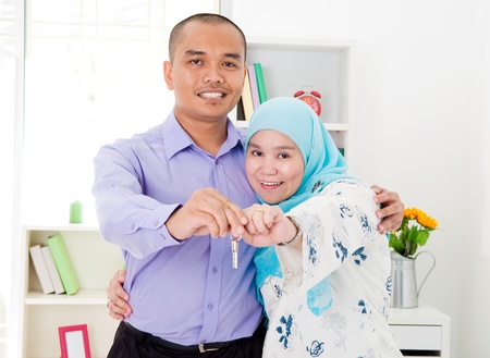 muslim couple showing their house key photo