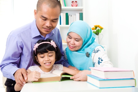 muslims: muslim family reading
