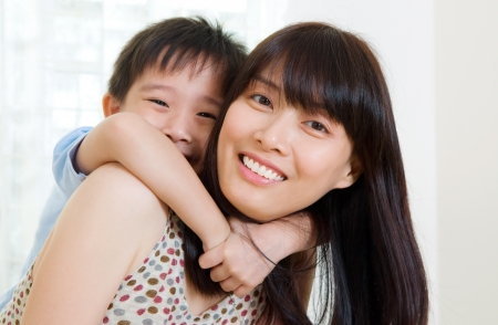 piggyback: Asian mother and her son