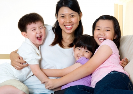Asian mother and her kids photo