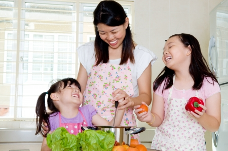 helping children: Asian family kitchen lifestyle