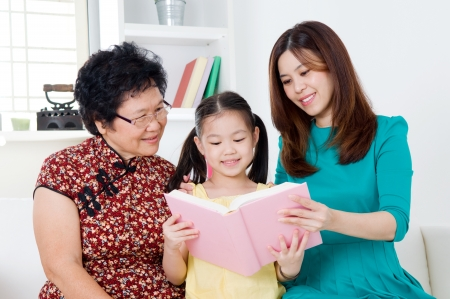 Asian family reading photo