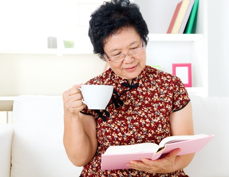 Asian senior woman reading photo