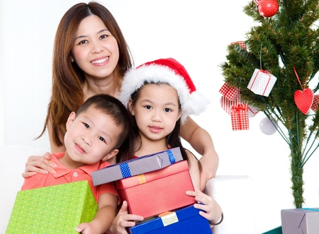 Asian mother and children celebrate Christmas photo