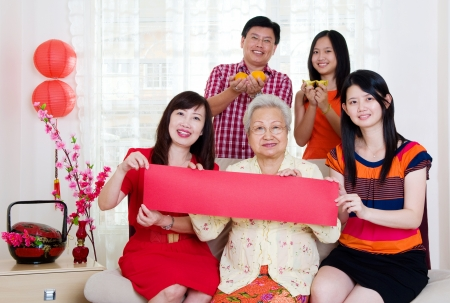 Asian family holding couplet   photo