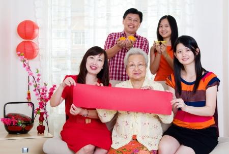 Asian family holding couplet Stock Photo - 22010137