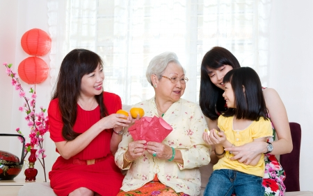 reunion: Asian three generations family celebrating chinese new year Stock Photo