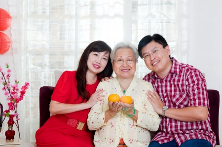 Asian senior woman and children celebrating chinese new year photo