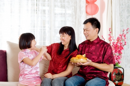 Asian girl greet her parents on chinese new year photo