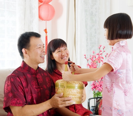 Asian family celebrating chinese new year photo