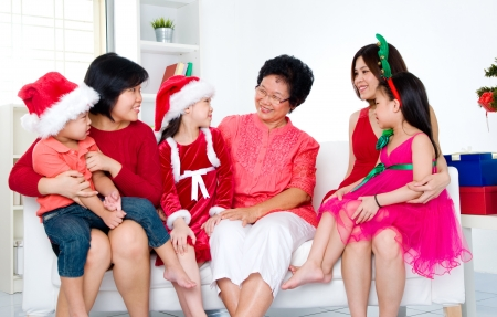 Asian family celebrating christmas photo