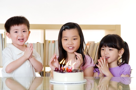 Asian kids singing birthday song photo