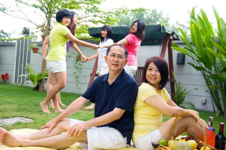 Asian family having outdoor activity photo