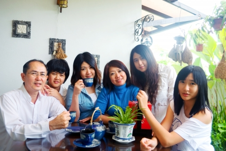 Asian family having tea time together photo