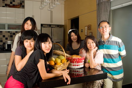 Asian family in the kitchen photo