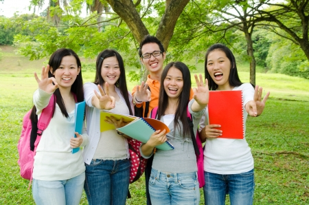 college campus: Asian students making ok sign  Stock Photo