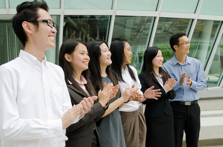 Asian business team clapping hands  photo