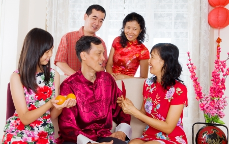 Asian family celebrating chinese new year Stock Photo - 24384341