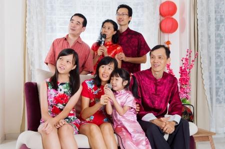 cheongsam: Chinese family singing Karaoke