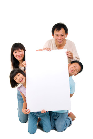 Asian family holding a white board photo