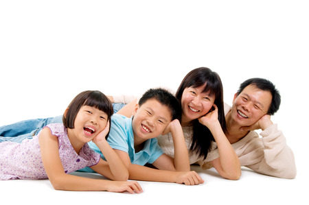 beautiful asian family isolated on white photo