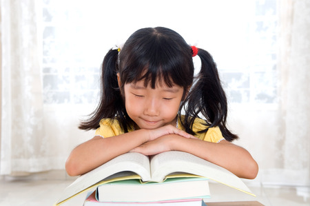 intelligently: Asian girl studying a book