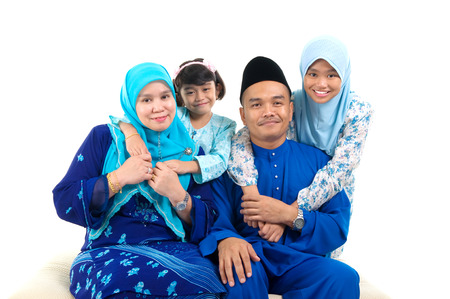 aidilfitri: Cheerful muslim family Stock Photo