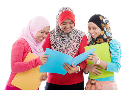 muslim students having group discussion photo