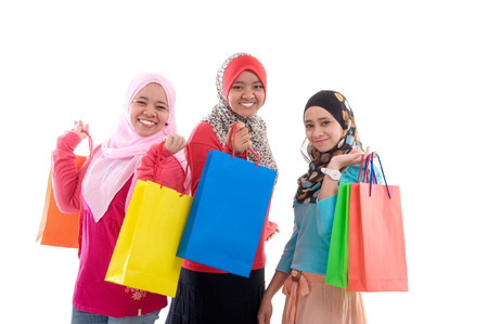 malay ethnicity: beautiful muslim girls with shopping bags Stock Photo
