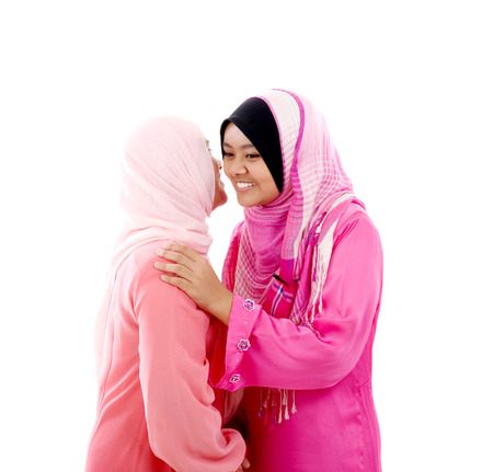 muslim women hugging photo