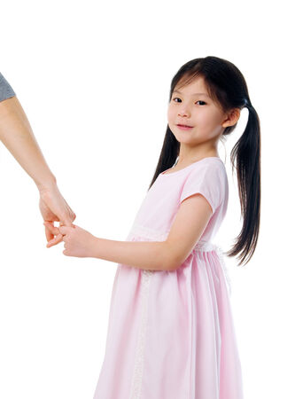 Asian girl holding her mothers hand photo